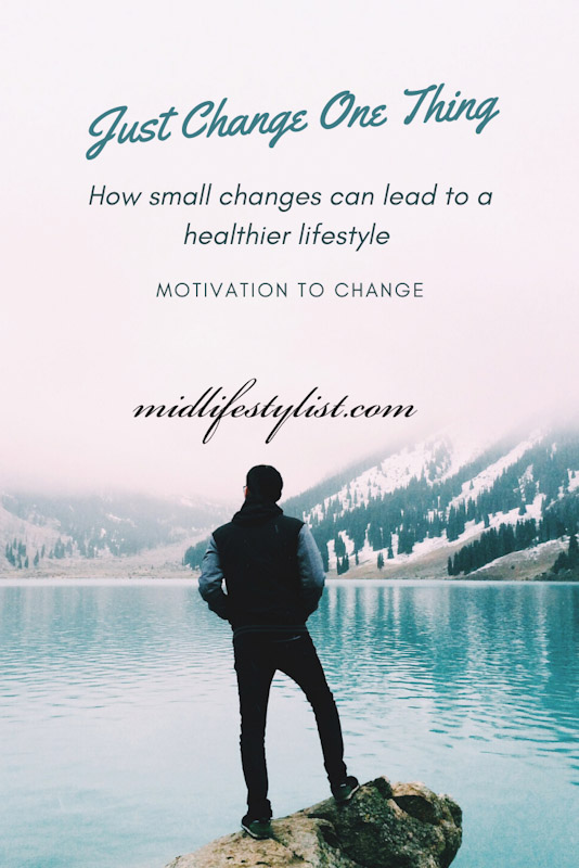 Just change one thing.  How small changes can lead to a healthier lifestyle.  Motivation to change one habit at a time and achieve long lasting success.  Image shows a man looking over a lake in the mountains.