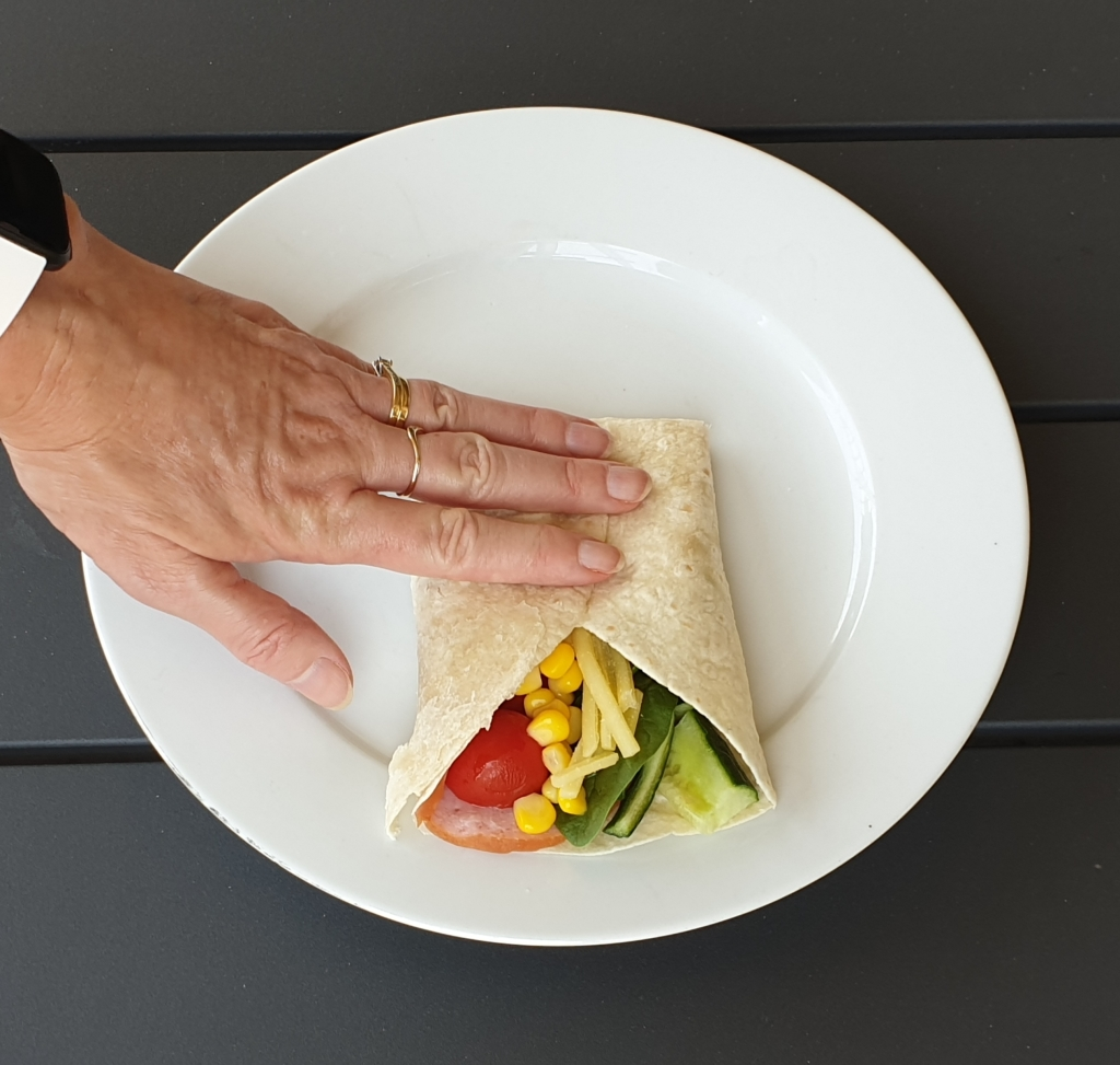 Step 4 how to make a healthy burrito - fold sides in.  Burrito may be toasted in a sandwich press